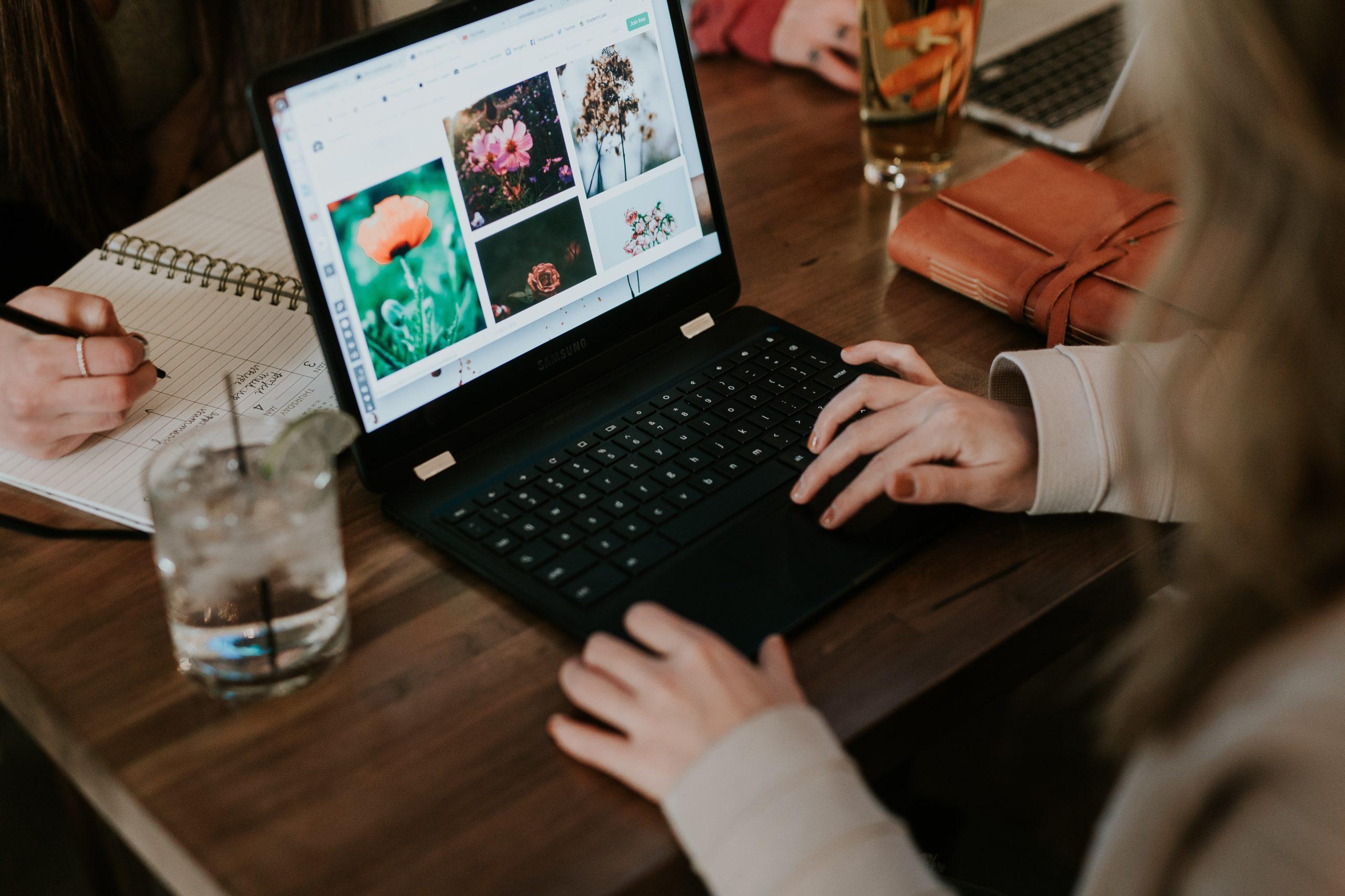 woman using black laptop computer